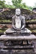 buddha statue at vatadage in polonnaruwa quadrangle - stock photo