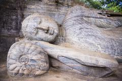 reclining buddha in nirvana at gal vihara rock temple, polonnaruwa - stock photo