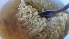 Mixing noodle. Junk food. Fast food. Life on the run. Stock Footage