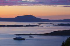 Sunset over giske island, sunnmore, more og romsdal, norway, scandinavia Stock Photos