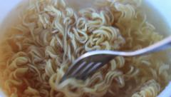 Mixing noodle. Instant soup. Life on the run. Stock Footage