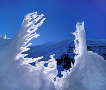 melting snow in front of a mountain, antartica - stock photo