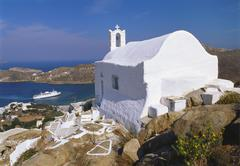 church by ormos harbour, ios island, cyclades, greece - stock photo