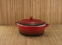 red saucepan on bamboo - stock photo