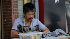 Sidewalk Tailor in Ho Chi Minh City Stock Footage