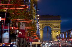 champs elysees and arc de triomphe dusk - stock photo