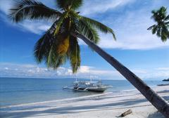 Outrigger motorboat moored on alona beach, panglao, bohol, philippines Stock Photos
