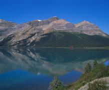 Reflection of the rockies in lake bow, banff national park, alberta, canada Stock Photos