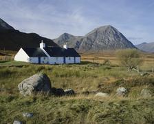 scotland, highlands, glencoe, croft by mountains - stock photo
