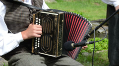 Accordionist man play folk music with accordion Stock Footage