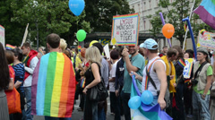 Annual gay lesbian solidarity rights parade main street flag Stock Footage