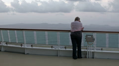 Woman by rail of cruise ship Caribbean Ocean sunset HD BM 1744 Stock Footage