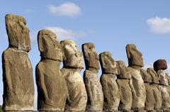 ahu tongariki where 15 moai statues stand with their backs to the ocean - stock photo