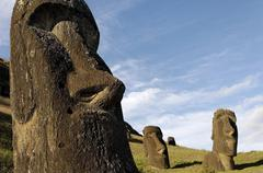 Moai in the rano raraku volcanic crater formed of consolidated ash (tuf) Stock Photos