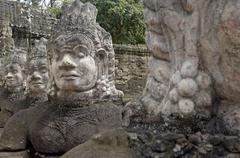southern causeway of angkor thom, flanked by gods - stock photo