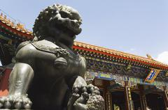 a mythical lion statue at yihe yuan (the summer palace) - stock photo