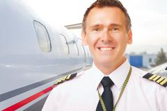Airline pilot at the airport Stock Photos