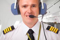 airline pilot - stock photo