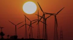 Wind farm - turning windmills on background of setting sun timelapse Stock Footage
