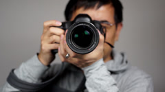 photographer pressing shutter - stock footage