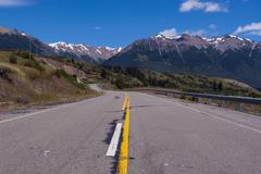 Road leading into los alerces national park, chubut, patagonia, argentina Stock Photos