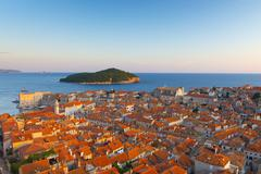 croatia, dalmatia, dubrovnik, old town (stari grad) with lokrum island beyond - stock photo