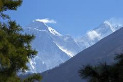 view to mount everest and lhotse from the trail near namche bazaar, nepal, hi - stock photo