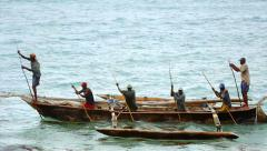 Local villagers sail traditional dhows to fishing grounds in the Indian Ocean. Stock Footage