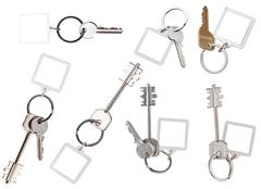 collection of keys on ring with blank keychain - stock photo