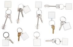 set of keys on ring with blank keychain - stock photo