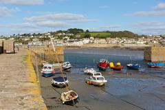 Boats in St Michaels Mount Harbour Cornwall England at low tide Stock Photos