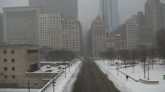 View of traffic and snow in Chicago on foggy day, video - stock footage