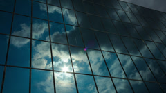 Glass skyscraper dark storm clouds reflection timelapse Stock Footage
