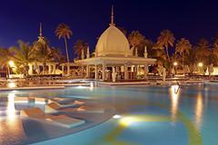 Tropical pool at night, aruba, caribbean Stock Photos