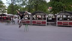 AERIAL: Skater jumping in central marketplace Stock Footage
