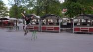 Stock Video Footage of AERIAL: Skater jumping in central marketplace