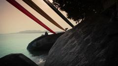 Romantic Sunset on Rocky Beach Stock Footage