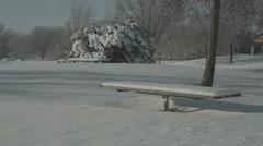 Snow-covered picnic tables Stock Footage