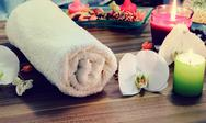 Stock Photo of Towel, aromatic candles and other spa objects.
