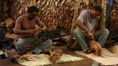 African villagers carve intricate designs into wood in Tanzania. - stock footage