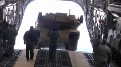 Loading an Abrams M1A1 tank on a C17 Globemaster Stock Footage