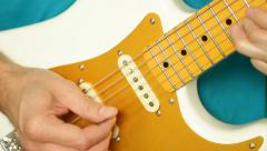 Close up of man's hands playing electric guitar Stock Footage