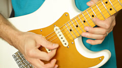 Hands playing guitar solo selective focus on picking fingers Stock Footage