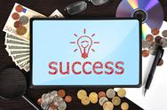 Stock Illustration of tablet with success