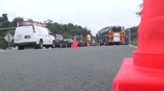 Rescue vehicles and traffic at accident WS Stock Footage
