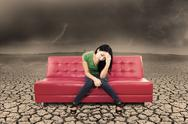 Stock Illustration of an image of stress female on sofa and dry ground
