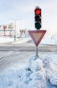Red traffic light at winter - stock photo