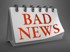 Bad News Concept on Desktop Calendar. Stock Illustration
