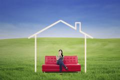 Pensive woman in dream house outdoor Stock Illustration