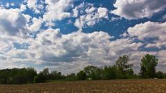 Cumulus clouds against light blue sky - 4K Ultra HD time lapse Stock Footage
